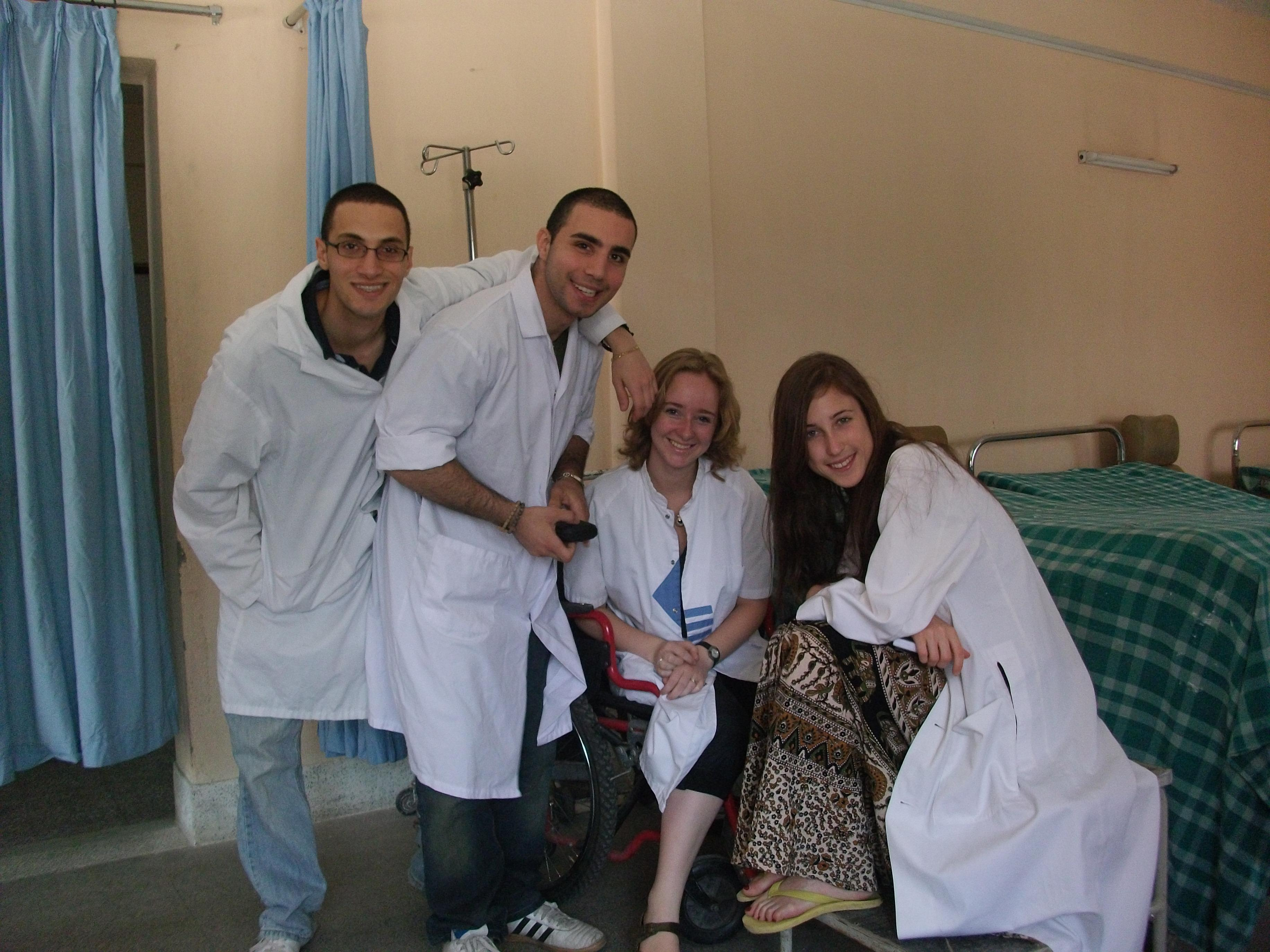 A female intern from Projects Abroad poses with local staff members during her nursing internship in Nepal.